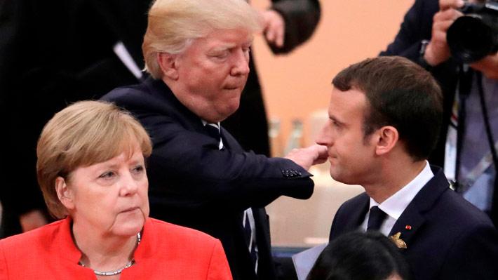 Abrazos versus mera cordialidad: Las diferencias que evidenciaron las visitas de Macron y Merkel a la Casa Blanca