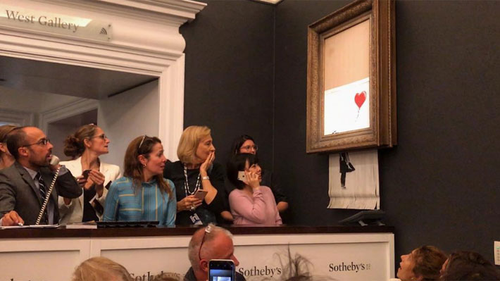 Una obra de Banksy se autodestruye tras subastarse por casi un millón y medio de dólares