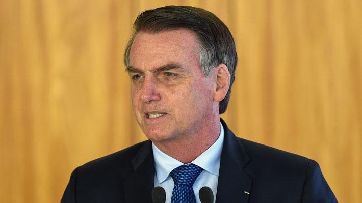 """Bolsonaro viajará a Davos en medio de polémica por depósitos bancarios """"sospechosos"""" de uno de sus hijos"""