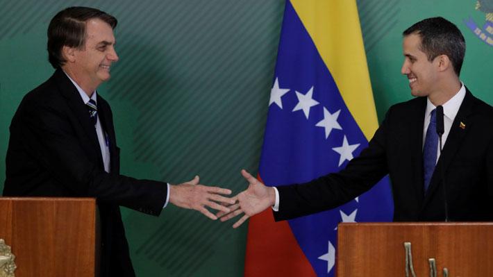 """Guaidó se reúne con Bolsonaro y asegura que volverá a Caracas """"a pesar de las amenazas"""""""