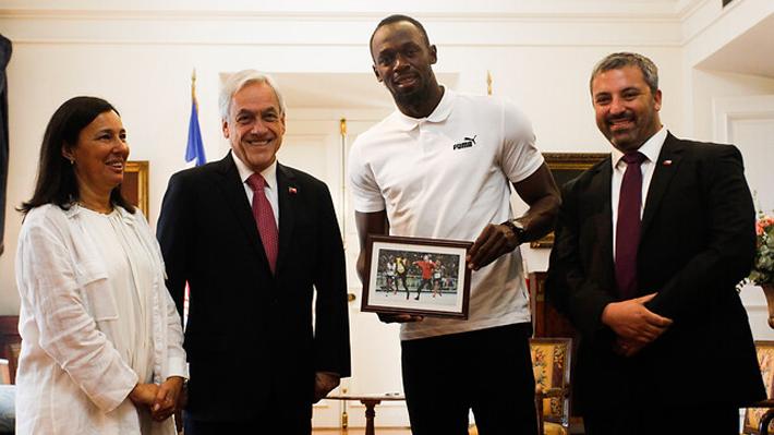 Meme, zapatillas y espuelas: Así fue la reunión de 25 minutos entre Piñera y Usain Bolt en La Moneda