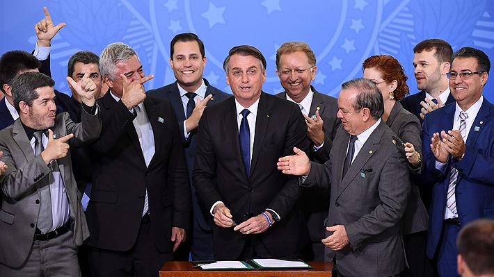 Nuevo decreto de Bolsonaro flexibiliza la tenencia de armas: Políticos, camioneros y periodistas podrán portarlas