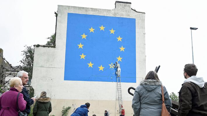 Banksy responde a eliminación de su mural sobre el Brexit y revela que tenía pensado intervenirlo cuando se concretara